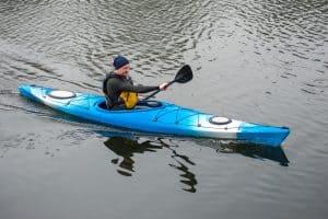 Men Kayaking on The River