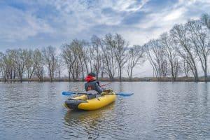 Fisher Woman With Inflatable Fishing Kayak